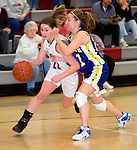 NAUGATUCK, CT- 02 JAN 06- 010207JT06- <br /> Naugatuck's Julie Piroscafo dribbles past Seymour's Joanna Schutter during Tuesday's game at Naugatuck. Seymour won 41-44.<br /> Josalee Thrift Republican-American