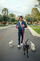SCOTTSDALE, AZ - Manager Tony La Russa of the Oakland Athletics walks with his dogs and cats for a portrait at his home during spring training in Scottsdale, Arizona in 1994. Photo by Brad Mangin