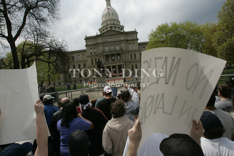 during a National Socialist Movement (Neo-Nazi) rally on the steps of the Michigan State Capitol, on Saturday, April 22, 2006 in Lansing, MI. (AP Photo/Tony Ding)