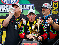Jun 18, 2017; Bristol, TN, USA; NHRA top fuel driver Clay Millican celebrates with crew after winning the Thunder Valley Nationals at Bristol Dragway. Mandatory Credit: Mark J. Rebilas-USA TODAY Sports