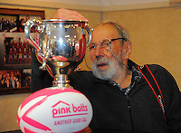 Photographer Peter Bush checks out the Lochore Cup during the Pink Batts Heartland Championship 2013 season launch at Waikanae RFC, Waikanae, New Zealand on Tuesday, 13 August 2013. Photo: Dave Lintott / lintottphoto.co.nz