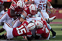 04 Sep 2010: Nebraska Cornhuskers' Rob Jensen (55), P.J. Smith (13), Alfonzo Dennard (15), and Lavonte David (4) take down Western Kentucky Hilltoppers running back Bobby Rainey (3) in the first quarter in at Memorial Staduim in Lincoln, Nebraska. Nebraska defeated Western Kentucky 49 to 10.