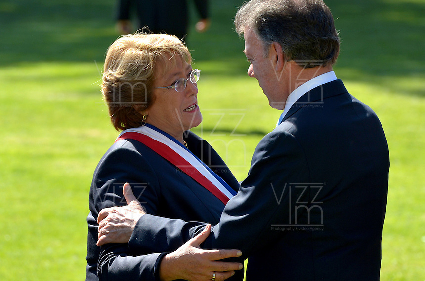 SANTIAGO -CHILE, 07-01-2012 Juan Manuel Santos, presidente de Colombia, saluda a Michellet Bachelet durante la ceremonia de posesión como presidenta de Chile, hoy 11 de marzo de 2014 en Santiago de Chile. El presidente de Colombia, Juan Manuel Santos entre otros mandatarios asistió al acto./ Juan Manuel Santos, president of Colombia, greets to Michelle Bachelet during the inauguration ceremony as president of Chile, today March 14 of 2014 in Santiago de Chile. Juan Manuel Santos, president of Colombia, among other leaders, attended the ceremony. Photo: VizzorImage /  Andrés Piscov - SIG /HANDOUT PICTURE; MANDATORY USE EDITORIAL ONLY/