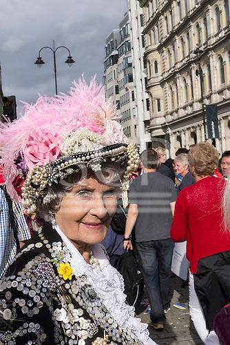 """Trafalgar Square, London, Engand. A smiling """"Pearly Queen"""" in the crowds."""