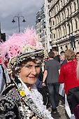 "Trafalgar Square, London, Engand. A smiling ""Pearly Queen"" in the crowds."