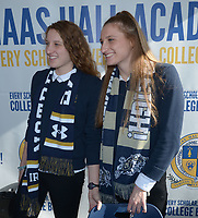 NWA Democrat-Gazette/ANDY SHUPE<br /> Haas Hall standout swimmers Luciana Thomas (left) and her twin sister Martina Thomas pose for photos Friday, Nov. 10, 2017, for friends before signing letters of intent to swim for Notre Dame and the Naval Academy respectively during a ceremony at the school in Fayetteville.