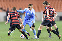 Houston, TX - Friday December 9, 2016: Zach Wright (10) of the North Carolina Tar Heels battles for the ball with Tanner Beason (3) and Drew Skundrich (12) of the Stanford Cardinal at the NCAA Men's Soccer Semifinals at BBVA Compass Stadium in Houston Texas.
