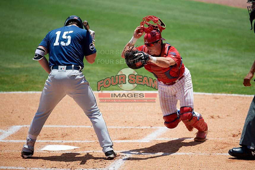 Clearwater Threshers catcher Austin Bossart (8) tracks down a loose ball behind Lakeland Flying Tigers first baseman Will Allen (15) during the second game of a doubleheader against the Lakeland Flying Tigers on June 14, 2017 at Spectrum Field in Clearwater, Florida.  Lakeland defeated Clearwater 1-0.  (Mike Janes/Four Seam Images)