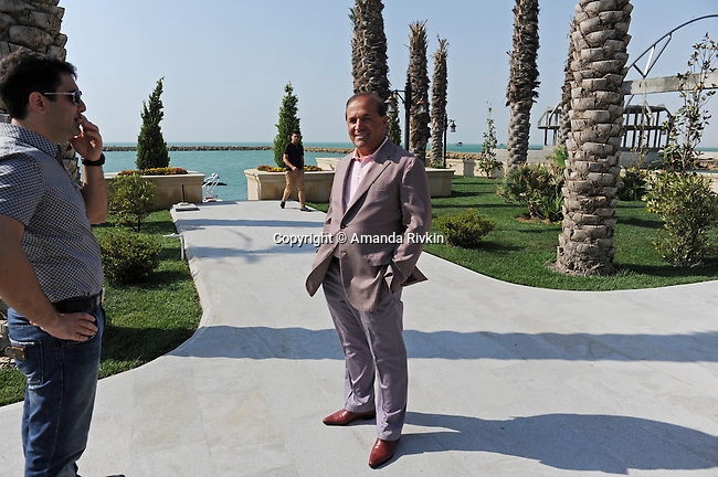(Center) Ibrahim Ibrahimov, an Azerbaijani oligarch and billionaire, is seen outside one of several of his homes along the Caspian Sea with his assistant and protege, Shahin Talibov, the Vice-President of Avesta Concern, in the Garadagh region just southwest of Baku, Azerbaijan on July 18, 2012.  Ibrahimov is the developer behind the Khazar Islands artificial islands project; in his private life, he enjoys building a home for his family, moving in, and then quickly tires of the property before building a new home on an adjacent lot on his seaside lands.