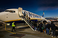 Spain. Valencia Province. Valencia Airport (Aeropuerto de Valencia). A Ryanair plane at sunset on tarmac. Passengers queue on line in order to enter the airplane by climbing stairs. Valencia Airport in Manises (also known as Manises Airport, is the tenth-busiest Spanish airport in terms of passengers. It is situated 8 km west of the city of Valencia.  Ryanair DAC is an Irish low-cost airline founded in 1984, and one of the largest European airline by scheduled passengers flown. 16.12.18  © 2018 Didier Ruef