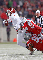 Ohio State Buckeyes defensive lineman Joey Bosa (97) and Ohio State Buckeyes defensive lineman Tommy Schutt (90) take down Indiana Hoosiers quarterback Nate Sudfeld (7) at Ohio Stadium in Columbus, Ohio on November 23, 2013.  (Chris Russell/Dispatch Photo)