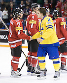 Ryan McGregor (Switzerland - 19), Anton Lander (Sweden - 16) - Team Sweden celebrates after defeating Team Switzerland 11-4 to win the bronze medal in the 2010 World Juniors tournament on Tuesday, January 5, 2010, at the Credit Union Centre in Saskatoon, Saskatchewan.