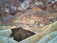 View of colorful rock formations off Golden Canyon Trail. Death Valley National Park, California