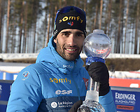 March 14th 2020, Kontiolahti, Finland;  Martin Fourcade of France celebrates with his trophy after the mens 12.5 km Pursuit competition at the IBU Biathlon World Cup in Kontiolahti, Finland, on March 14, 2020. Fourcade ends his career now at the end of the season in Kontiolahti where he took his first World Cup victory exactly 10 years ago on March 14, 2010.