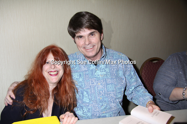 Designer Jane Elissa poses with Author Dean Koontz at Romantic Times Booklovers Annual Convention 2011 - The Book Industry Event of the Year - April 6th to April 10th at the Westin Bonaventure, Los Angeles, California for readers, authors, booksellers, publishers, editors, agents and tomorrow's novelists - the aspiring writers. (Photo by Sue Coflin/Max Photos)
