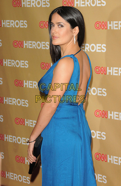 SALMA HAYEK .at The CNN Heroes: An All Star Tribute held at The Kodak Theatre in Hollywood, California, USA, November 22nd 2008.                                                                  .half length long blue dress back rear behind over shoulder silver hoop earrings .CAP/DVS.©Debbie VanStory/Capital Pictures