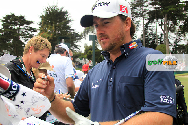 Graeme McDowell (NIR) signs autographs for the many fans as he walks to the 18th tee during Tuesday's Practice Day of the 112th US Open Championship at The Olympic Club, San Francisco,  California, 12th June 2012 (Photo Eoin Clarke/www.golffile.ie)