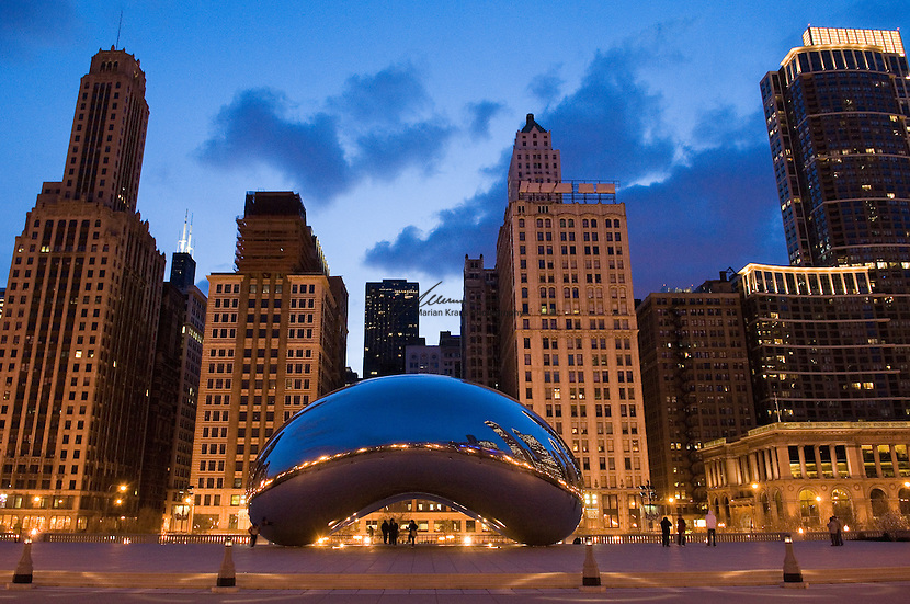"Looking west from Millenium Park at Cloud Gate with, Michigan Avenue and Chicago's skyline at dusk. The architecture of Chicago has influenced and reflected the history of American architecture. The city of Chicago, Illinois features prominent buildings in a variety of styles by many important architects. Since most buildings within the downtown area were destroyed by the Great Chicago Fire in 1871, Chicago buildings are noted for their originality rather than their antiquity..Beginning in the early 1880s, architectural pioneers of the Chicago School explored steel-frame construction and, in the 1890s, the use of large areas of plate glass. These were among the first modern skyscrapers and amongst their most famous architects were William LeBaron, John Wellborn Root Sr., Daniel Burnham and Charles Atwood. Louis Sullivan was perhaps the city's most philosophical architect. Realizing that the skyscraper represented a new form of architecture, he discarded historical precedent and designed buildings that emphasized their vertical nature. This new form of architecture, by Jenney, Burnham, Sullivan, and others, became known as the ""Commercial Style,"" but it was called the ""Chicago School"" by later historians..Since 1963, a ""Second Chicago School"" emerged, largely due to the ideas of structural engineer Fazlur Khan. Some of Chicago's skyscrapers such as the John Hancock Center, Willis Tower (formerly known as the Sears Tower) and The Trump International Hotel and Tower are amongst the tallest buildings in the world."