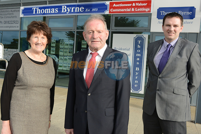 Forty years in business ... auctioneer Tommy Byrne with wife Kathleen and son Brendan. Photo: Andy Spearman.