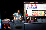 An old man prepares Wan Tan Mee in his stall at a local kopitiam (traditional Chinese breakfast and coffee shop) in capital Georgetown of Penang in Malaysia. Photo: Sanjit Das/Panos