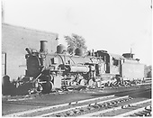 3/4 fireman side view of K-37 #490 beside engine house at Chama.<br /> D&amp;RGW  Chama, NM