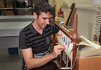 Sergio is assembling the folios of the facsimile with natural string at the printing studio of Scriptorium SL in Valencia, Spain. Picture by Manuel Cohen