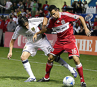 Chicago Fire midfielder Marco Pappa (16) is pressured by Real Salt Lake forward Fabian Espindola (16).  The Chicago Fire defeated Real Salt Lake 1-0 at Toyota Park in Bridgeview, IL on August 1, 2009.