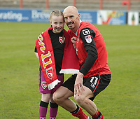 Kevin Ellison of Morecambe poses for a picture with his daughter at there last home match of the season during the Sky Bet League 2 match between Morecambe and Wycombe Wanderers at the Globe Arena, Morecambe, England on 29 April 2017. Photo by Stephen Gaunt / PRiME Media Images.