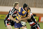 James Maher & Siale Piutau tackle Warren Smith during the Air NZ Cup rugby game between Bay of Plenty & Counties Manukau played at Blue Chip Stadium, Mt Maunganui on 16th of September, 2006. Bay of Plenty won 38 - 11.
