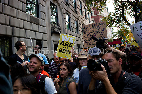 New York, New York<br /> October 11, 2011<br /> <br /> A coalition of community groups allied with Occupy Wall Street transplanted their critique from downtown Manhattan to the Upper East Side, rallying in front of the stately apartment buildings of billionaires that included News Corporation CEO Rupert Murdoch, Koch Industries vice president David Koch and New York Private Bank &amp; Trust CEO president Howard Milstein.<br /> <br /> The participants of the event, that began on September 17, are mainly protesting against social and economic inequality, corporate greed, and the influence of corporate money and lobbyists on government, among other concerns.