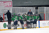 Notre Dame Fighting Irish of Batavia team meeting during a varsity ice hockey game against the Brockport Blue Devils during the Section V Rivalry portion of the Frozen Frontier outdoor hockey event at Frontier Field on December 22, 2013 in Rochester, New York.  (Copyright Mike Janes Photography)