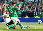 June 11th 2017, Dublin, Republic Ireland; 2018 World Cup qualifier, Republic of Ireland versus Austria;  Kevin Long of Ireland is tackled by Guido Burgstaller of Austria