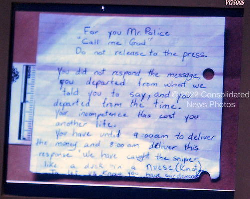 A note found near the shooting scene of Conrad Johnson on October 23, 2003 in Aspen Hill, Maryland, is displayed on a screen during the trial of sniper suspect John Allen Muhammad in courtroom 10 at the Virginia Beach Circuit Court in Virginia Beach, Virginia on November 3, 2003.<br /> Credit: Lawrence Jackson - Pool via CNP