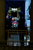 United States Military Honor Guard stands near the casket of former Senator John McCain, Republican of Arizona, in the United States Capitol Rotunda in Washington, DC on August 31, 2018 in Washington, DC. McCain, a United States Military veteran and longtime Senator, will lay in state inside the Capitol Rotunda for one day prior to being laid to rest on September 1, 2018 at the United States Naval Academy in Annapolis, Maryland. Credit: Alex Edelman / CNP