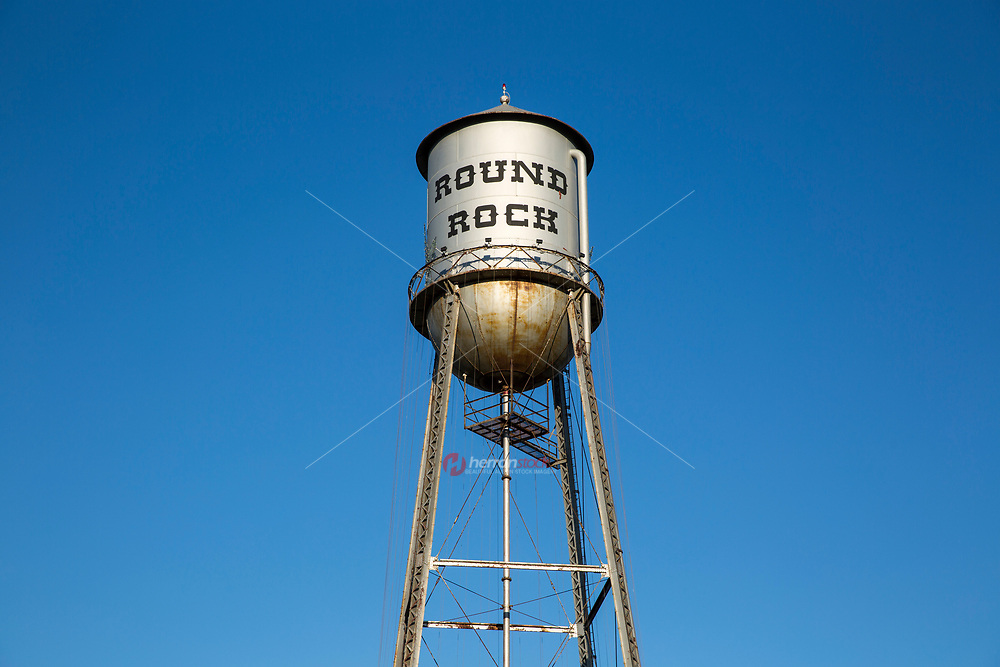 The City of Round Rock Water Tower has a colorful history. As the city's first modern water works system included a redevelopment of the town well and a 60,000 gallon, 130 foot tall water storage tank.  This project was completed in 1935 by the Public Works Administration.  Both the well and the storage tank still exist as iconic Round Rock landmarks, but are no longer operational.