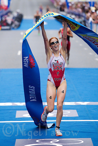 10 APR 2011 - SYDNEY, AUS - Paula Findlay celebrates victory at the women's ITU World Championship Series triathlon in Sydney, Australia  (PHOTO (C) NIGEL FARROW)