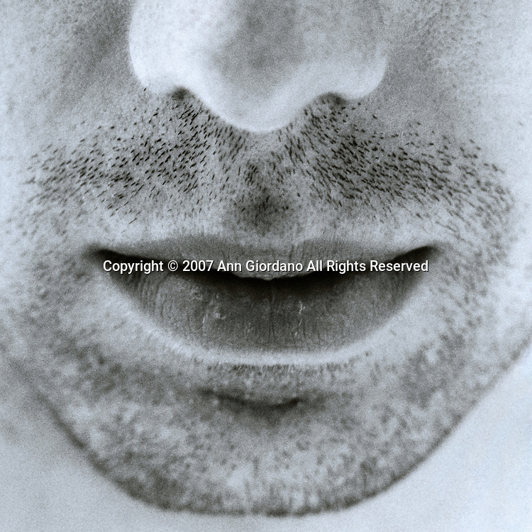 Close up of unshaven man's nose and mouth