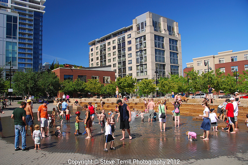 Families gather to play in the fountain at Jamison Square located in the Pearl District of NW Portland