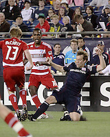 iNew England Revolution forward Zack Schilawski (15) slides to intercept the ball from FC Dallas midfielder/forward Dax McCarty(13) with FC Dallas midfielder/forward Atiba Harris(16) in close pursuit.  The New England Revolution drew FC Dallas 1-1, at Gillette Stadium on May 1, 2010