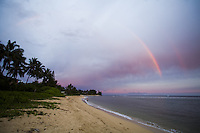 Double rainbow over a beach in Waialua at sunset