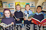 BOOKWORMS: At the opening of the new library at St Oliver's NS in Ballylongford on Friday were l-r: Clodagh Swanser, Lucy Aherne, Ciara O'Donoghue and Victor Flahive..