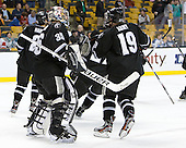 Alex Beaudry (PC - 35) and Derek Army (PC - 19) celebrate Army's goal which gave Providence the lead 4:33 into the game. - The Boston College Eagles defeated the Providence College Friars 4-2 in their Hockey East semi-final on Friday, March 16, 2012, at TD Garden in Boston, Massachusetts.