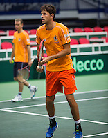 29-01-2014,Czech Republic, Ostrava,  Cez Arena, Davis-cup Czech Republic vs Netherlands, practice, Captain Jan Siemerink (NED) passes in the background, Robin Haase (NED)foreground <br /> Photo: Henk Koster
