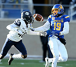 BROOKINGS, SD - DECEMBER 9: Jake Wieneke #19 from South Dakota State University battles for the ball with Prince Smith, Jr. #46 from the University of New Hampshire during their FCS quarterfinal game Saturday afternoon at Dana J. Dykhouse Stadium in Brookings, SD. (Photo by Dave Eggen/Inertia)