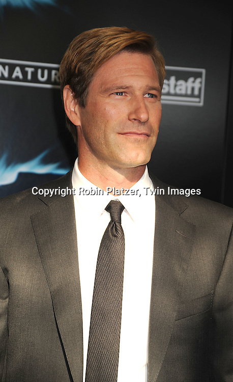 "actor Aaron Eckhart..posing at The World Premiere of ""The Dark Knight""  on July 14, 2008 at The AMC Loews Lincoln Square in New York City.  The premiere was sponsered by VISA and Belstaff.....Robin Platzer, Twin Images"