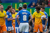 Sido Jombati of Wycombe Wanderers holds the ball as he teams teammates the free kick is his to take (he scores form it) during the Sky Bet League 2 match between Portsmouth and Wycombe Wanderers at Fratton Park, Portsmouth, England on 23 April 2016. Photo by Andy Rowland.
