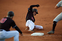 Batavia Muckdogs Kobie Taylor (38) slides into third base during a NY-Penn League game against the West Virginia Black Bears on June 26, 2019 at Dwyer Stadium in Batavia, New York.  Batavia defeated West Virginia 4-2.  (Mike Janes/Four Seam Images)