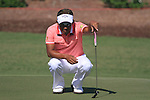 Thongchai Jaidee lines up his putt on the 8th green during Day 1 of the Dubai World Championship, Earth Course, Jumeirah Golf Estates, Dubai, 25th November 2010..(Picture Eoin Clarke/www.golffile.ie)