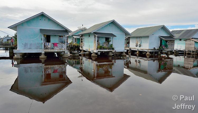 Houses built over the water in Kuala Bubon, in Indonesia's Aceh province. The community of 118 houses was built by the ACT Alliance after the village's tsunami survivors refused to accept government plans to relocate them inland far from the sea. After the houses were built, the community then successfully fought a government plan to demolish part of the new village to make way for a new highway.