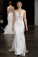 """Model walks runway in a """"Hope"""" bridal gown from the Alyne by Rita Vinieris Fall 2017 collection on October 7th, 2016 during New York Bridal Fashion Week."""